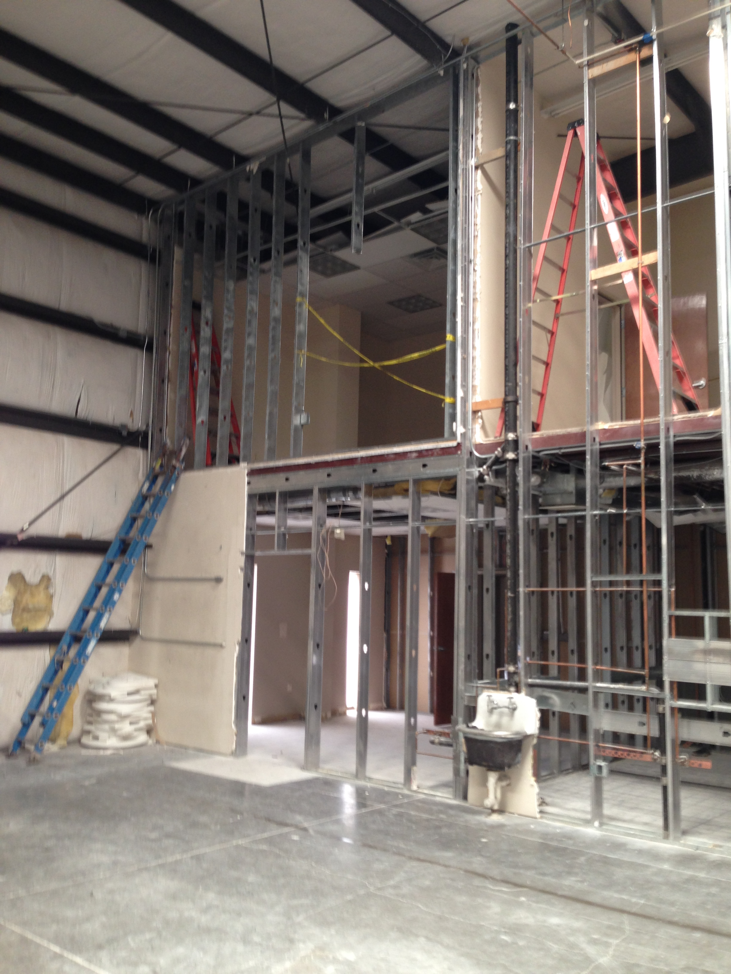 Demolition to enlarge restrooms and upper offices