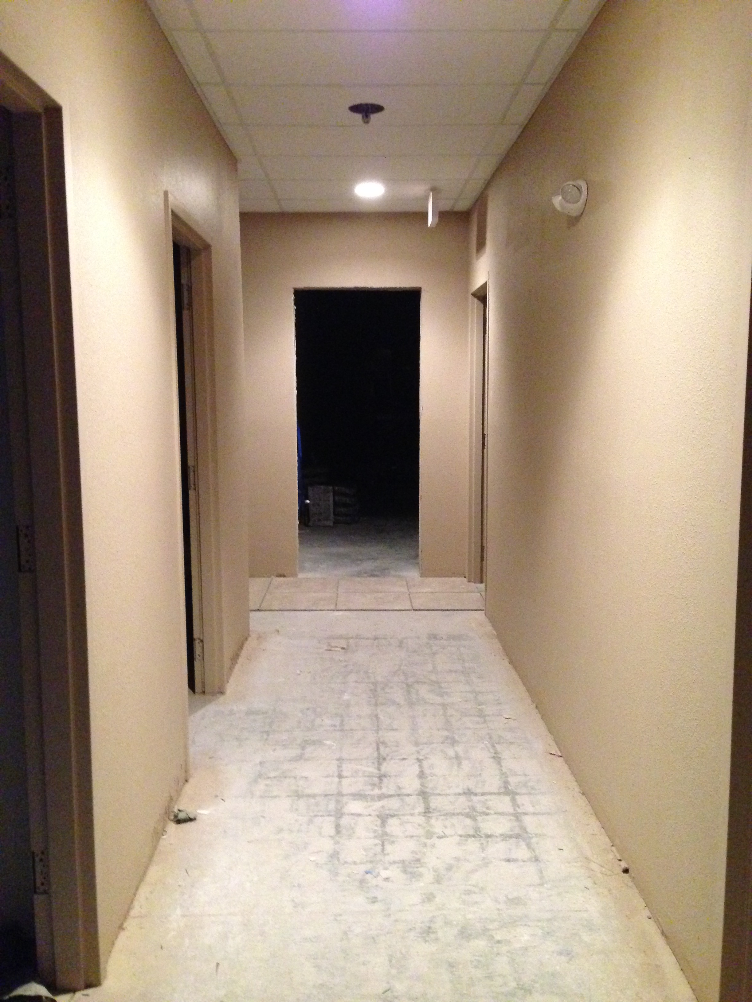 Hallway from office area towards restrooms and warehouse